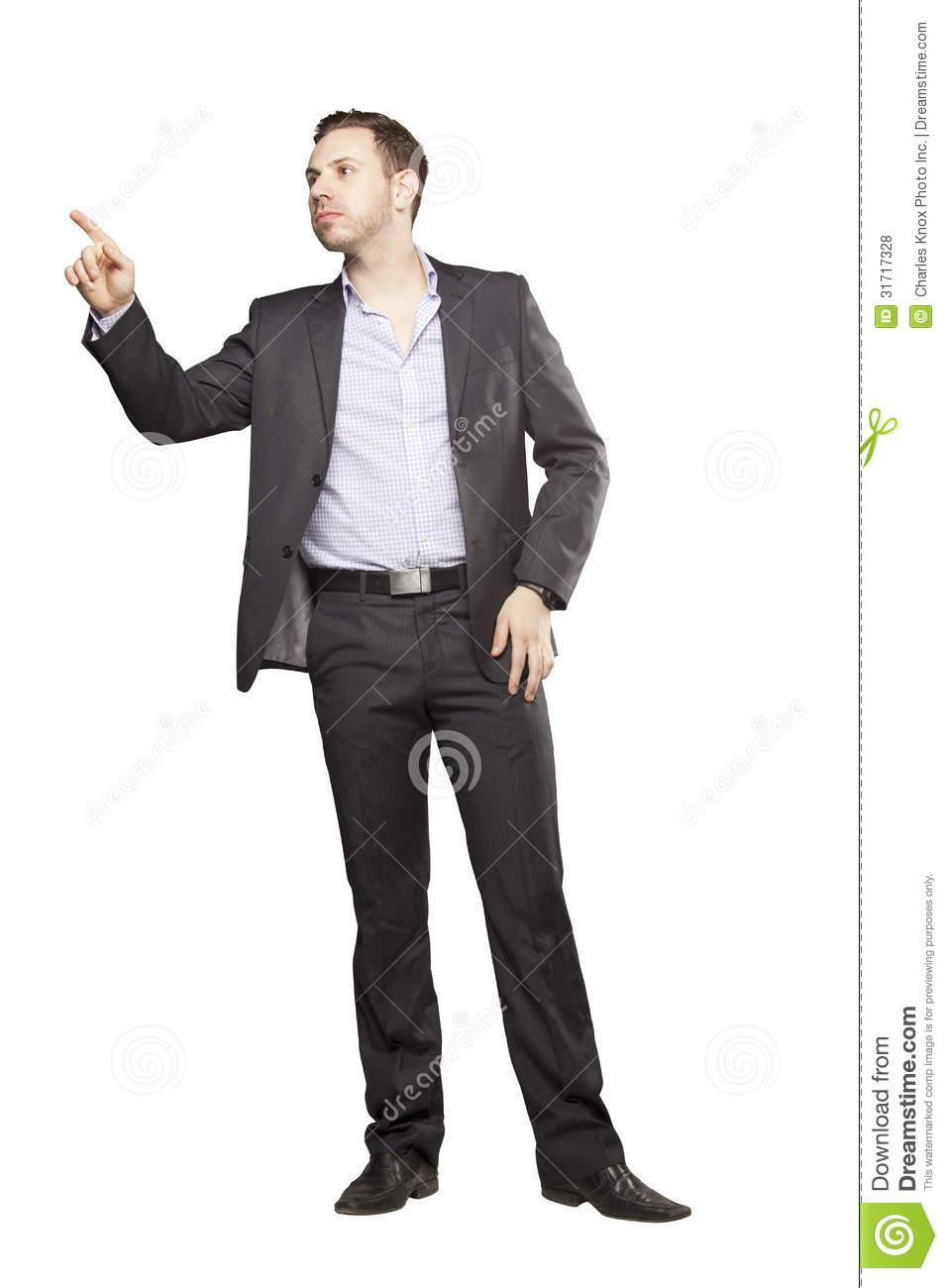 Young Man In Black Suit Gesturing Royalty Free Stock ...