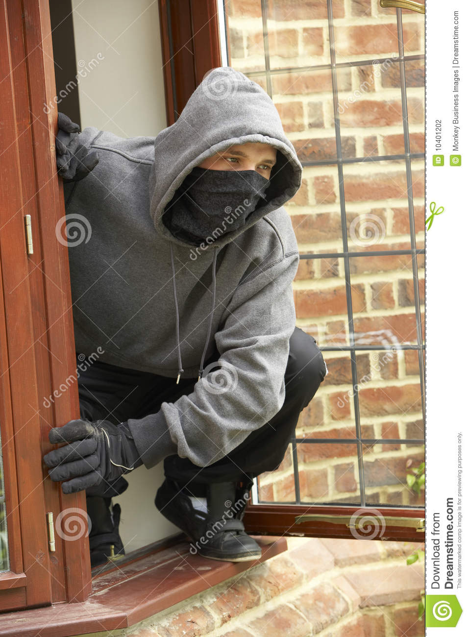 Young Man Breaking Into House Stock Photography Image