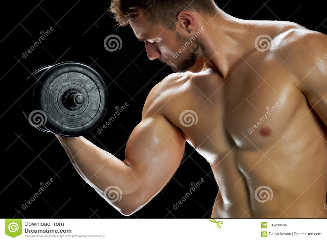 Young Man Is Building Muscles Stock Photo - Image of goal