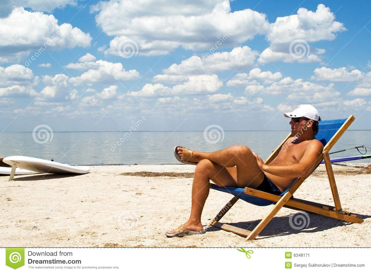 Young Man On A Chair On A Beach Stock Image Image Of Coastline Water 6348171