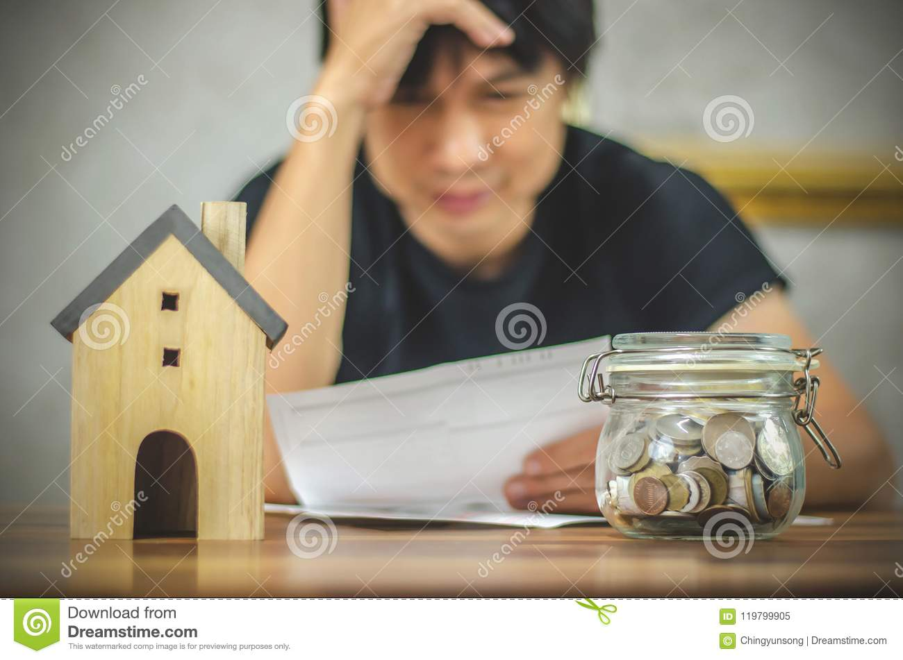 Man checking bills and having financial problems with home debt, Money concept., real estate, buy an apartment