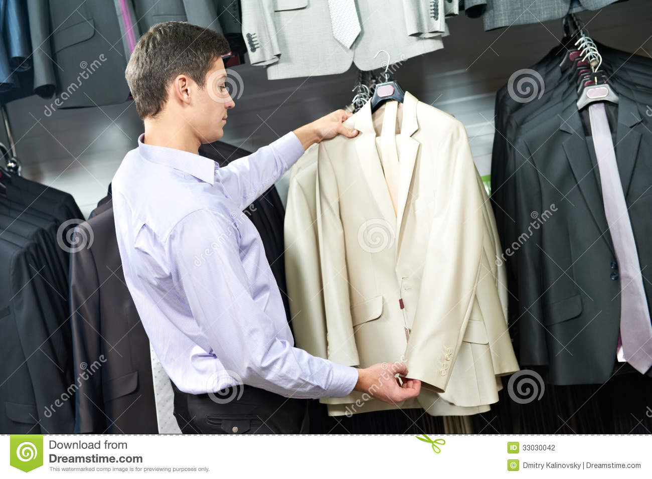 choosing suit in clothes store stock photo