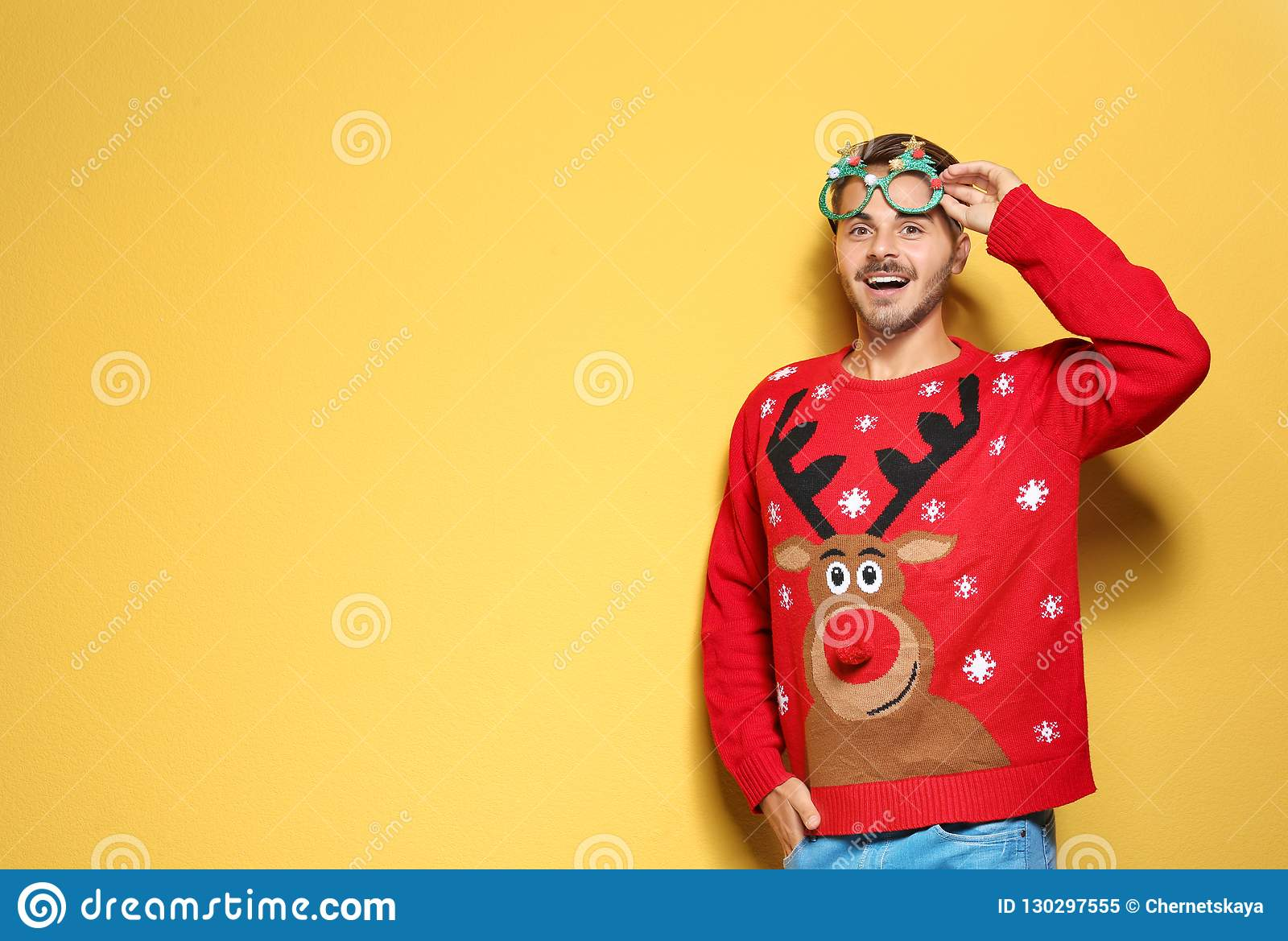 2 Person Christmas Sweater.Young Man In Christmas Sweater With Party Glasses On Color