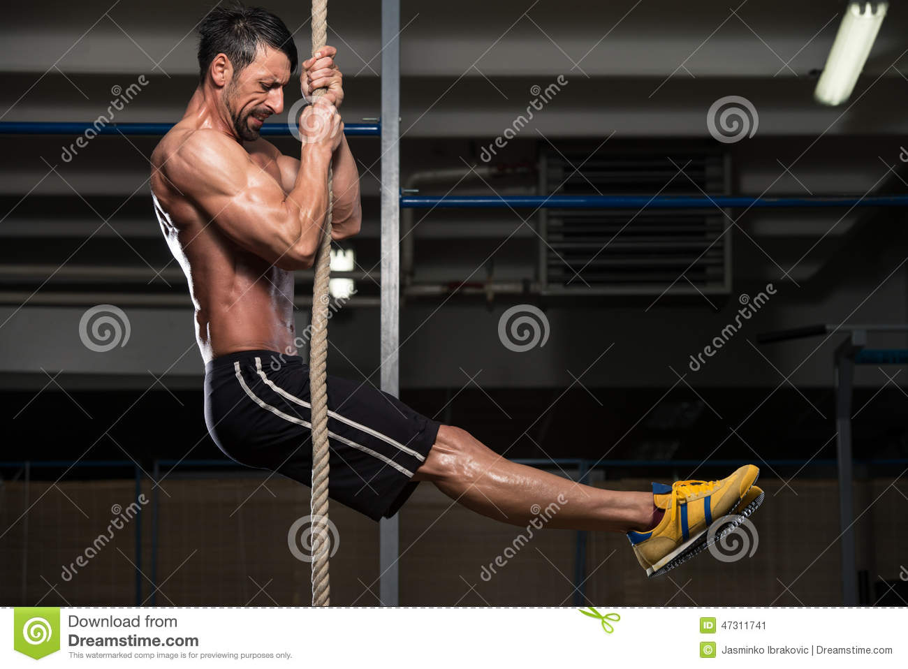young man climbing a rope stock image image of athletic 47311741