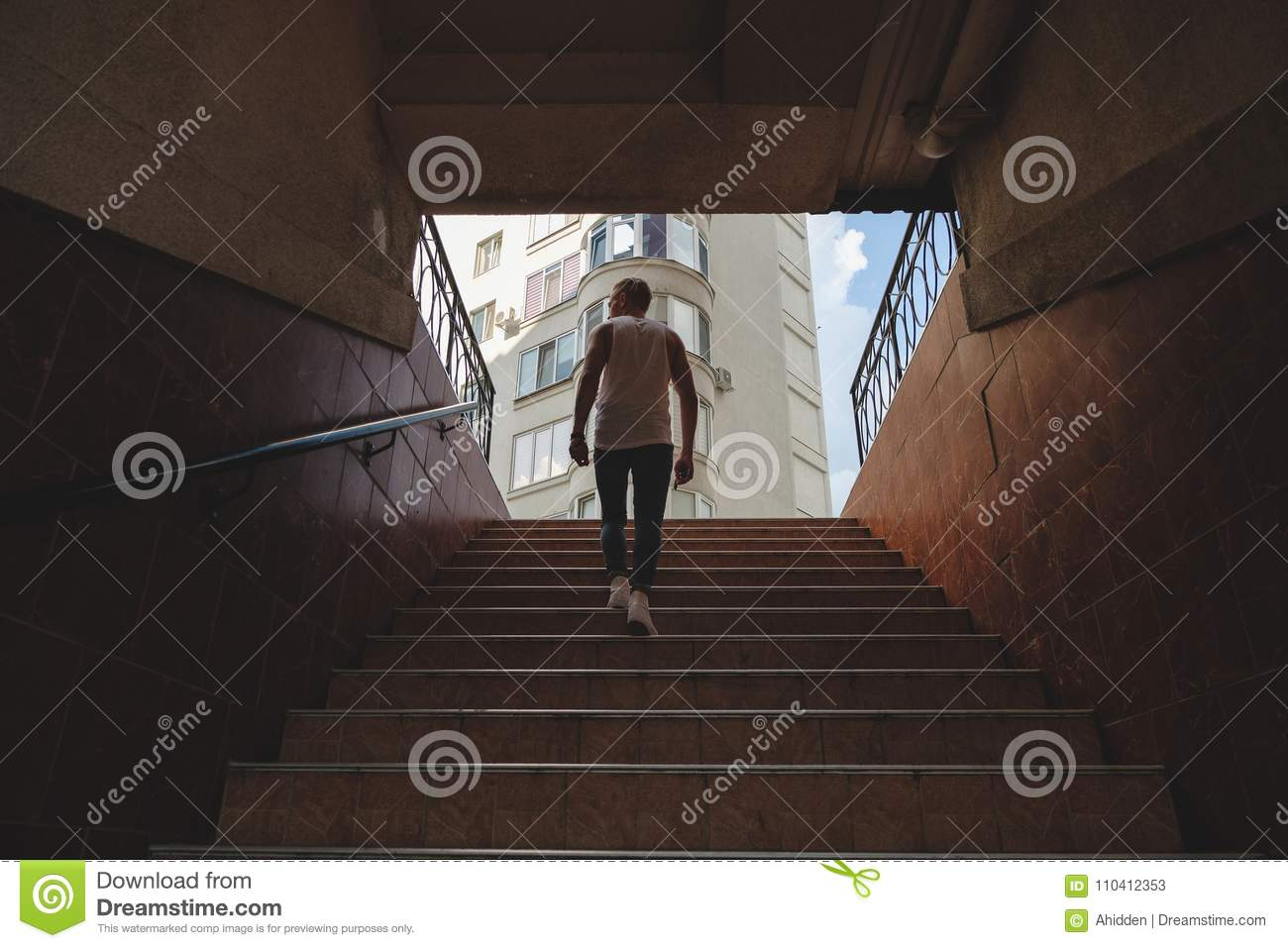 Download Young Man Climbing Stairs In Pedestrian Subway Stock Image - Image of pedestrian, coming: 110412353
