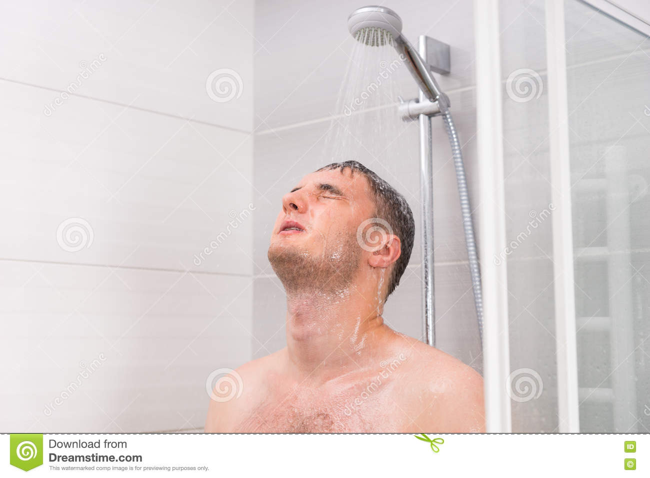 Royalty Free Stock Photo. Young Man With Closed Eyes Taking A Shower In The Bathroom Stock