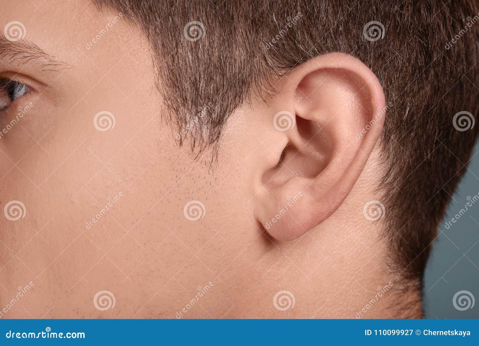 Young man, closeup of ear.