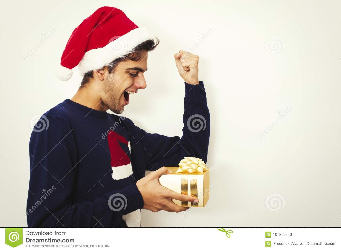 young man with clothes and christmas gift
