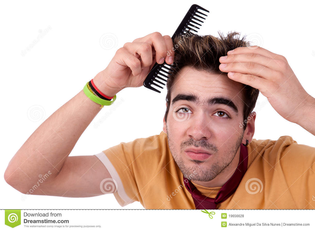 Young Man Combing His Hair With A Comb Stock Photo Image