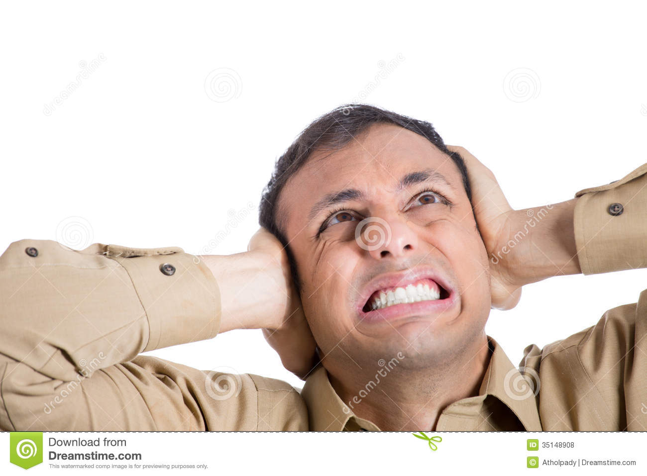 A Young Man Covering His Ears To Shut Out Noise Royalty Free Stock ...