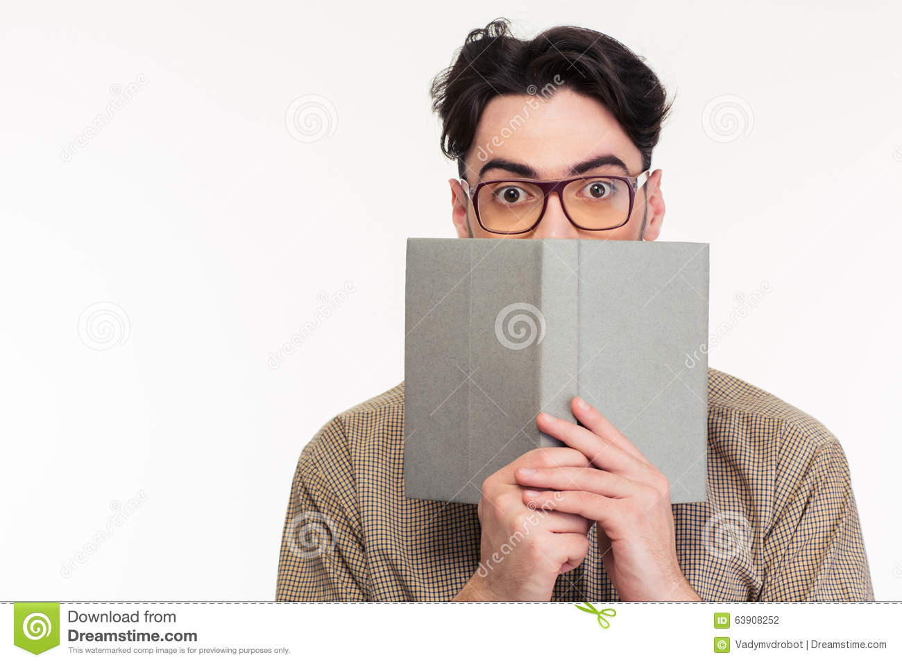Book Covering Face : Young man covering his face with book