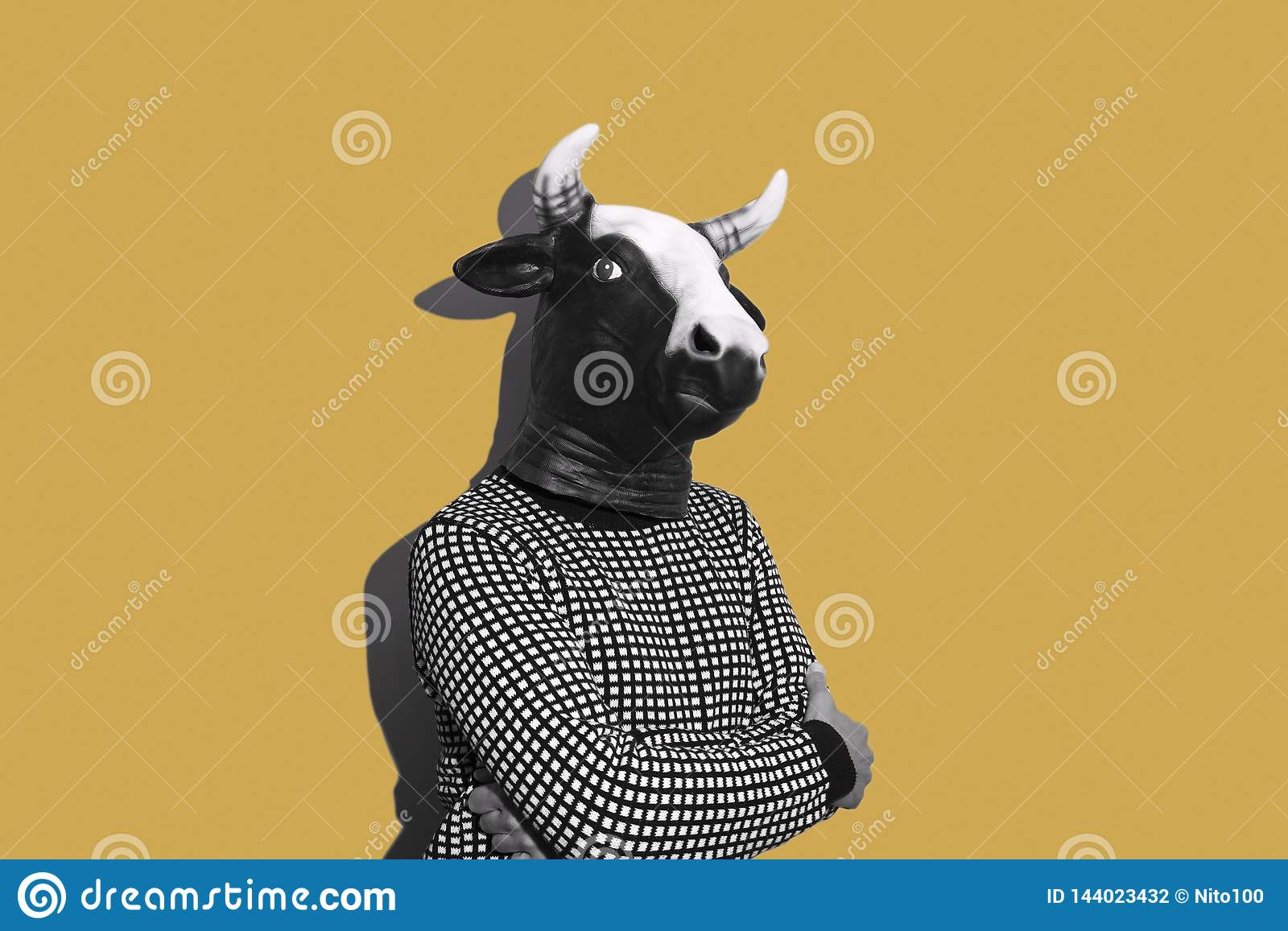 Young man with a cow mask