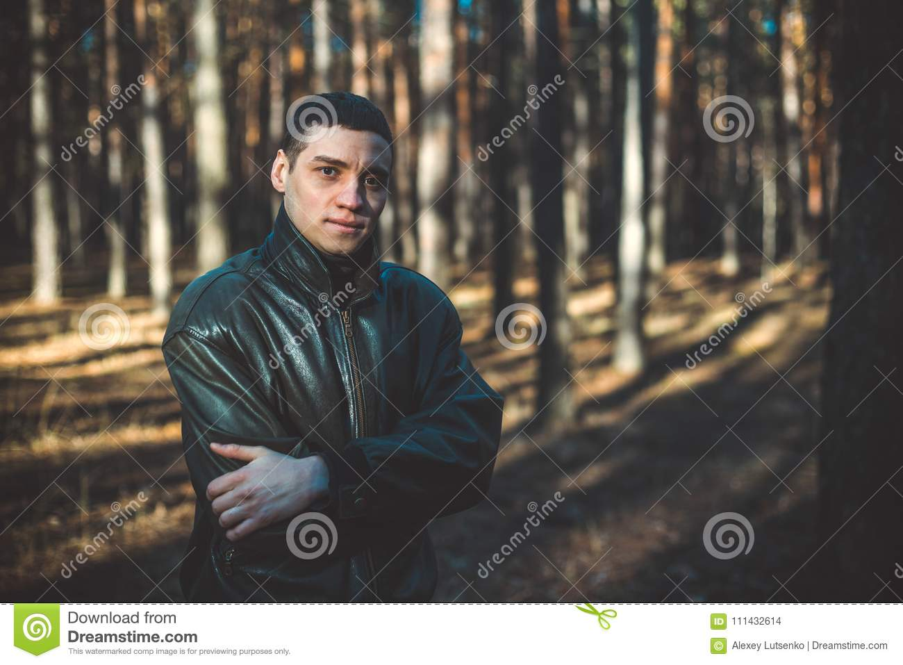 A Young Man Of Criminal Appearance In A Black Leather Jacket Stock
