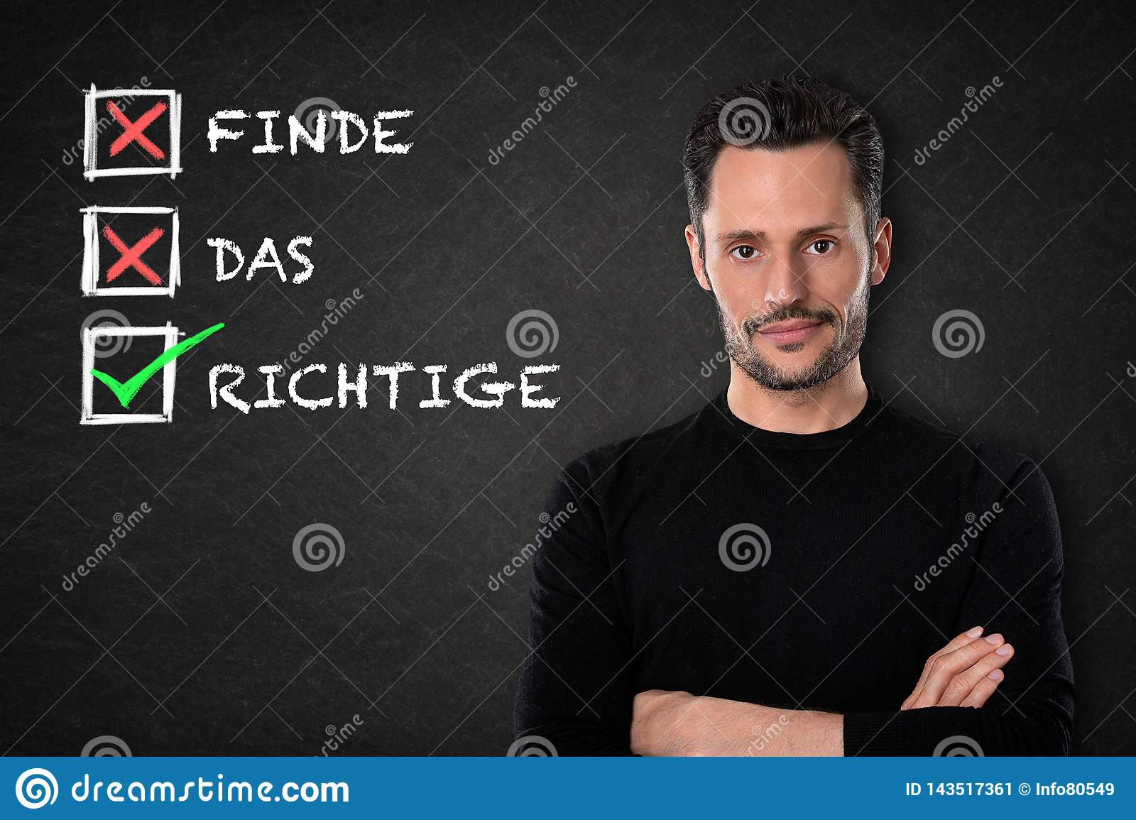 Young man with crossed arms, `Find das Richtige` text on a chalkboard background. Translation: `Find the right one`