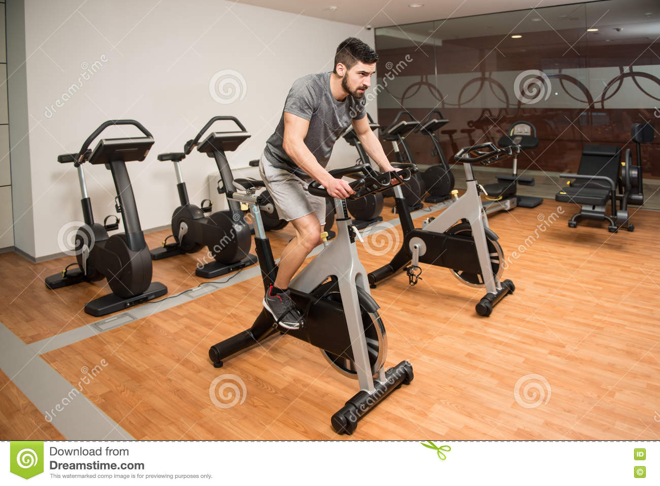 Young Man Cycling On Bike Bodybuilding Trainer Stock Photo Image