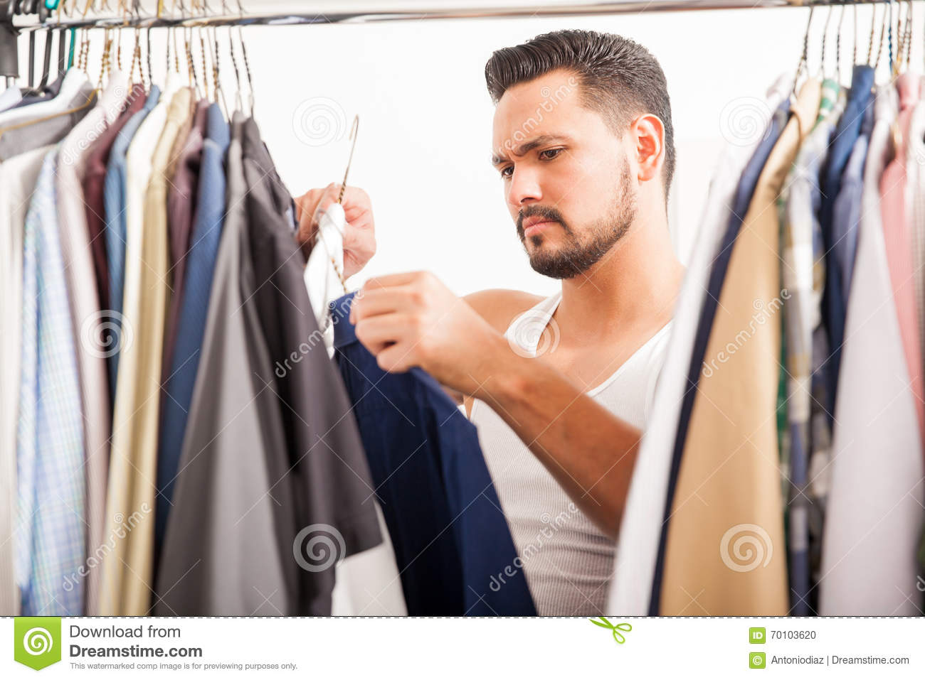 Young Man Deciding What Clothes To Wear Stock Photo ...