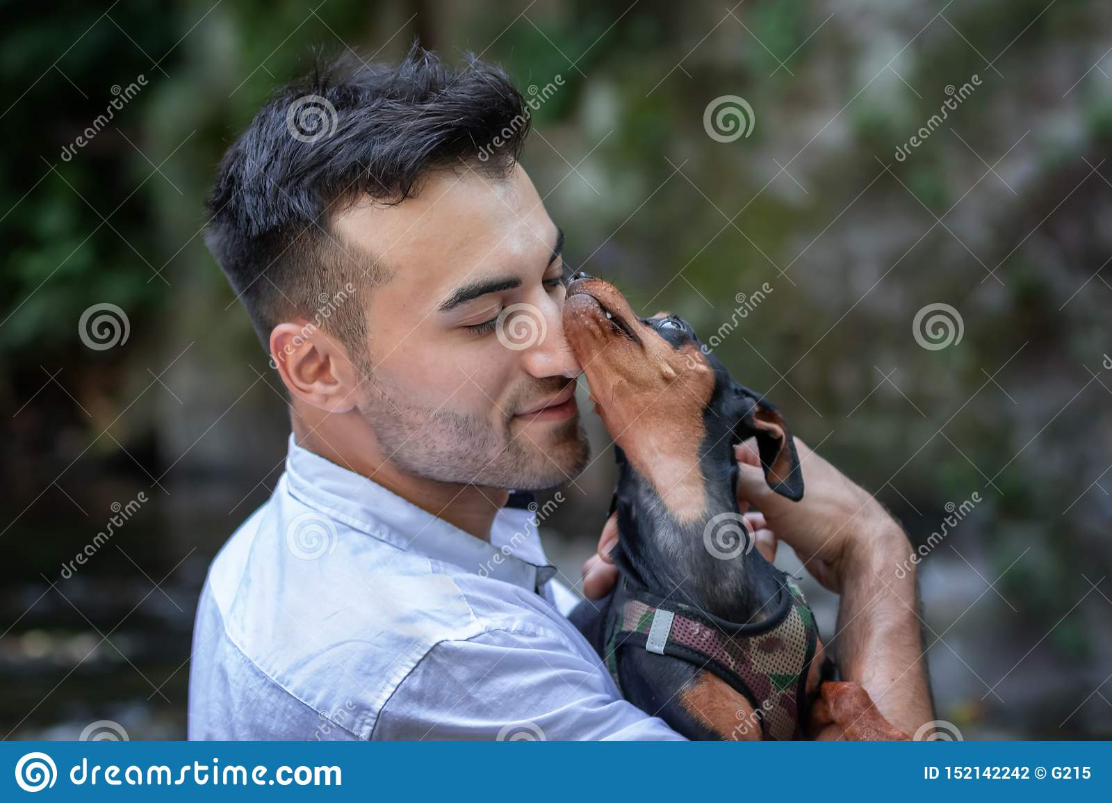 young man with dog, outdoor
