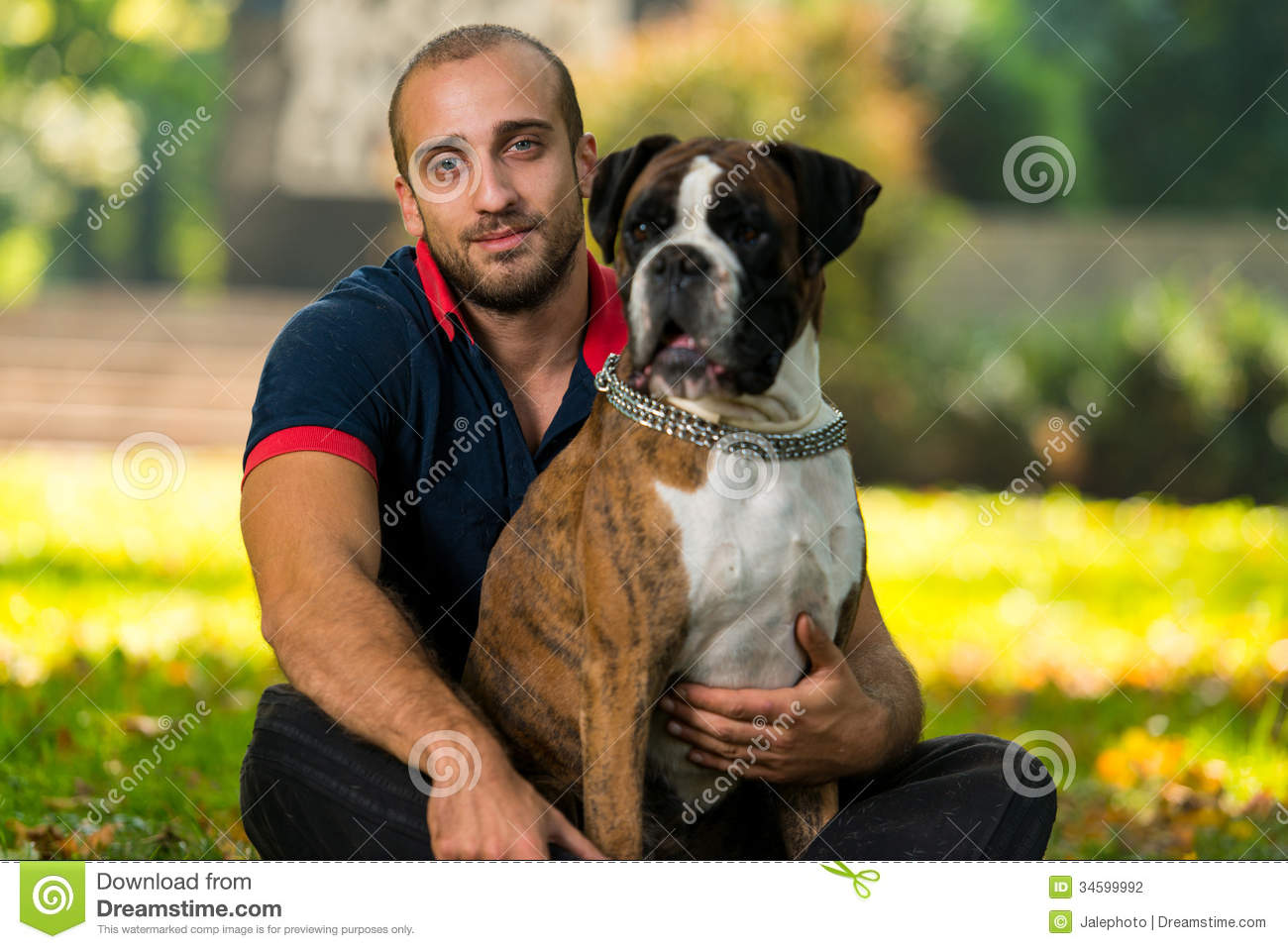 Man On Dog : Young man with dog stock photo image of happiness