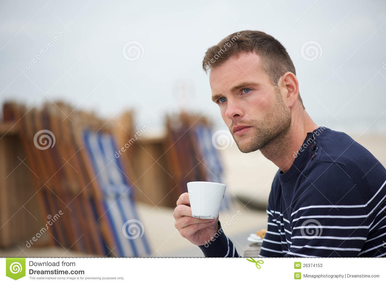 Young Man Drinking His Coffee At The Beach Stock s Image