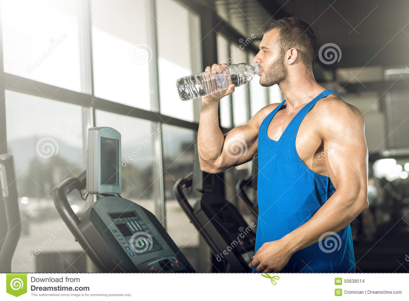 Download Young Man Drinking Water In Gym Stock Photo - Image of exhausted, indoors: 55638514