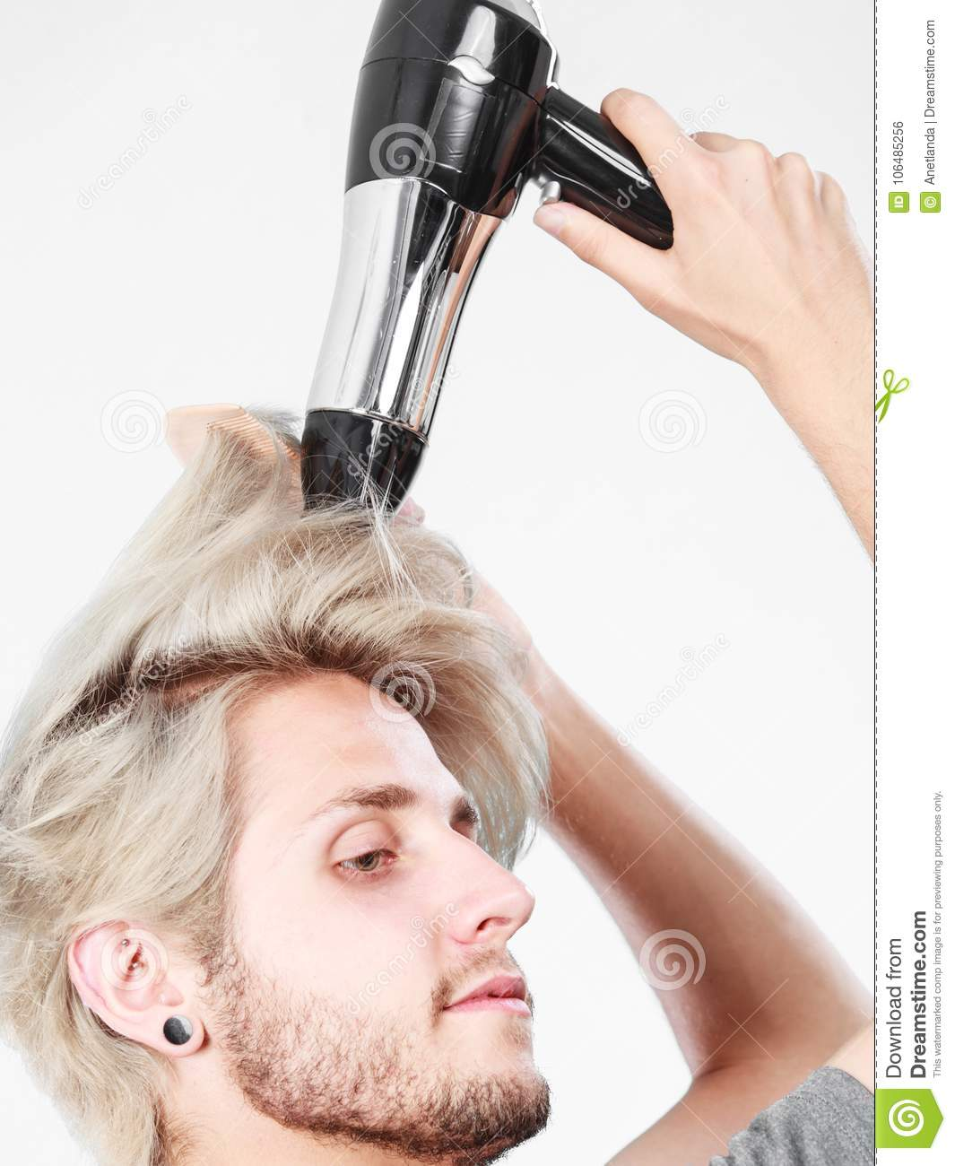 Young Man Drying Hair With Hairdryer Stock Photo Image Of Haircare