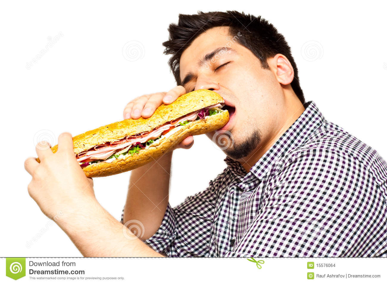 Young Man Eating A Freshly Made Sub Meat Feast San Stock