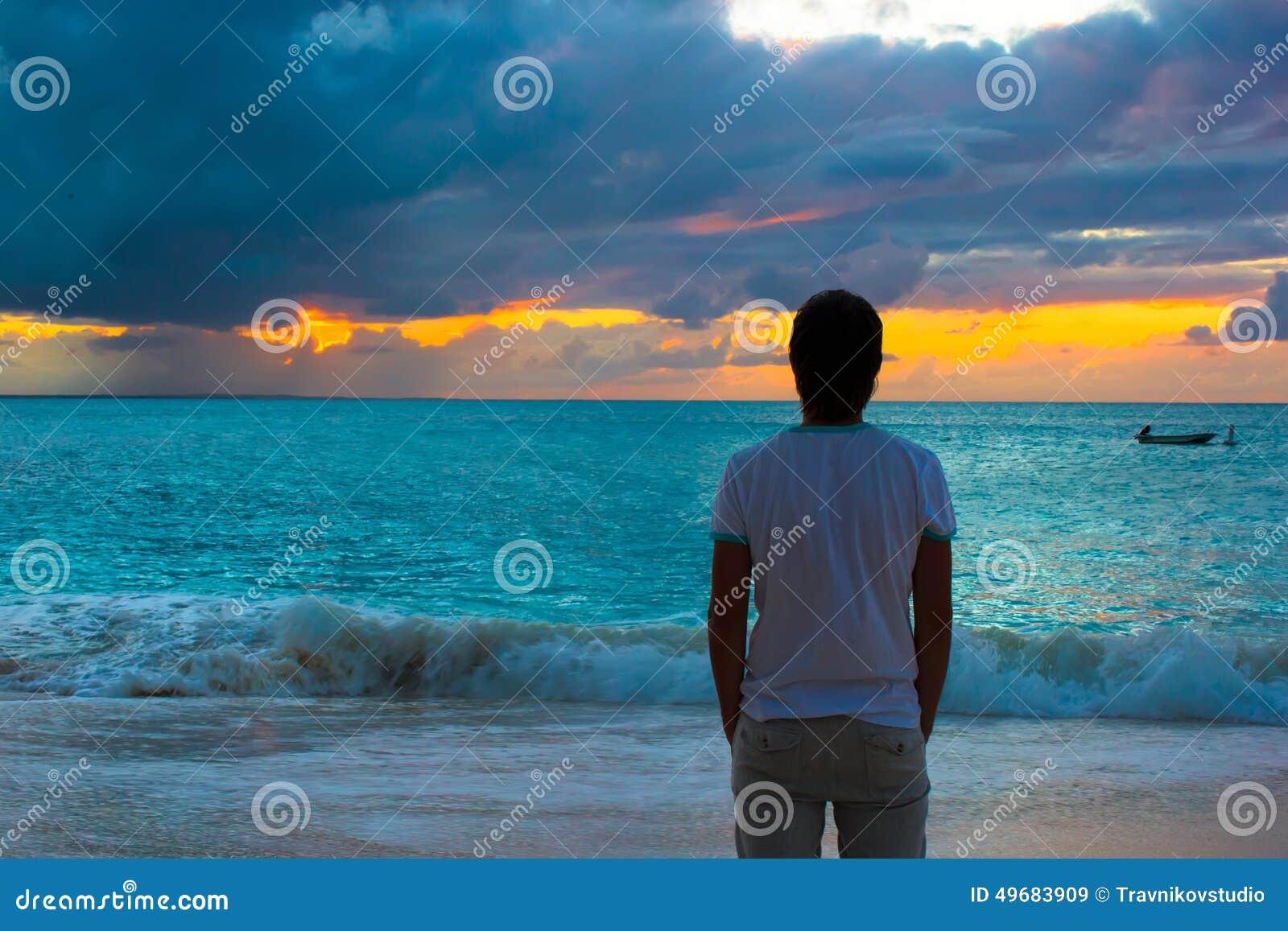 Young Man Enjoying Sunset During Beach Vacation Stock Image - Image ... eb411943100