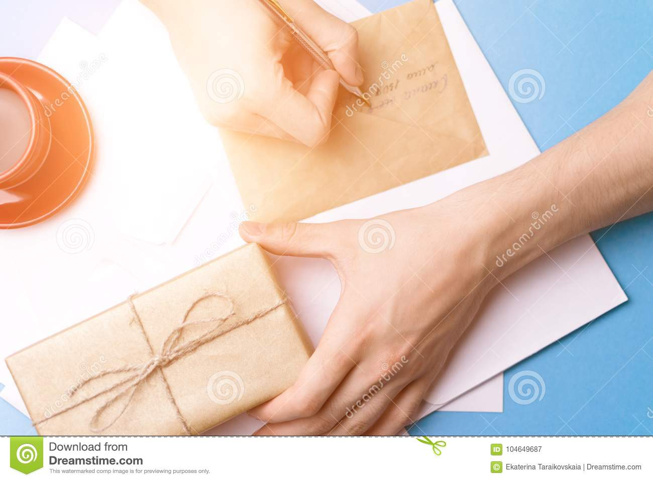 A young man examines and signs the letter. The concept of correspondence.