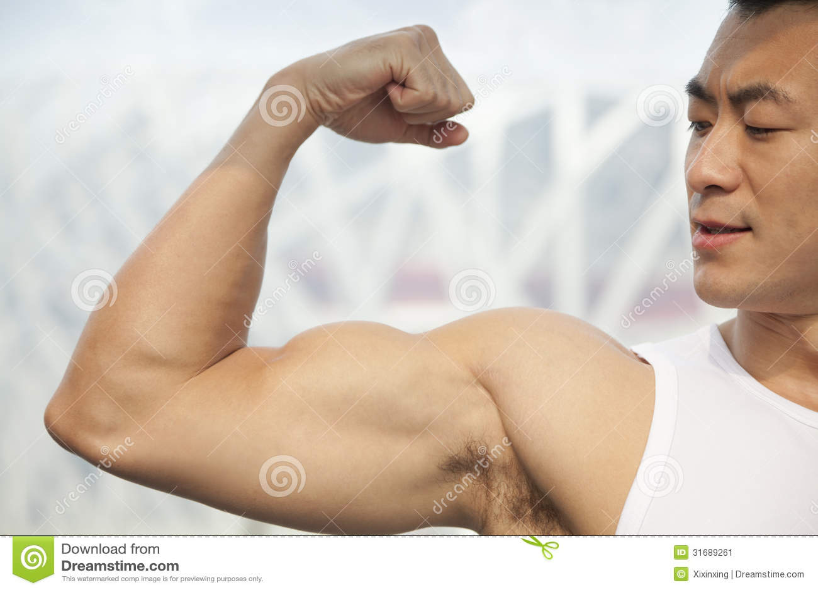 Young men flexing biceps
