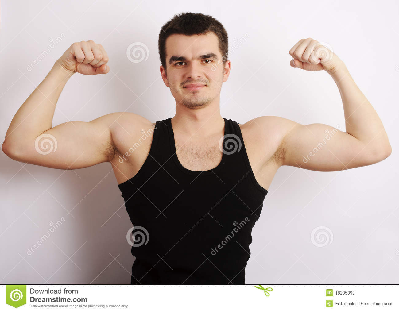 Royalty Free Stock Images: Young man flexing his muscles
