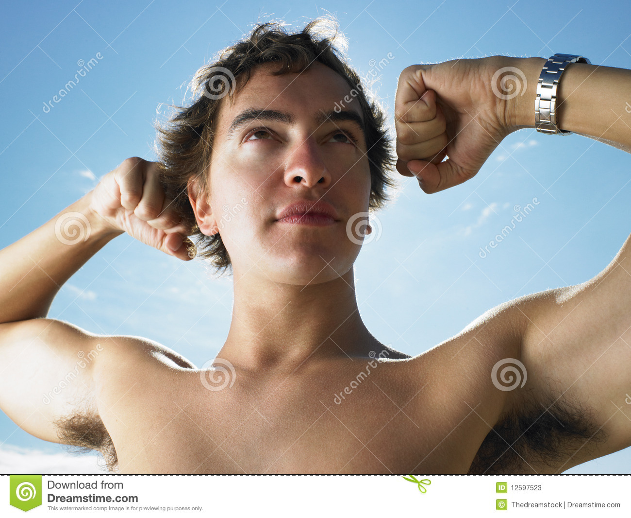 Stock Photos: Young Man Flexing Muscles