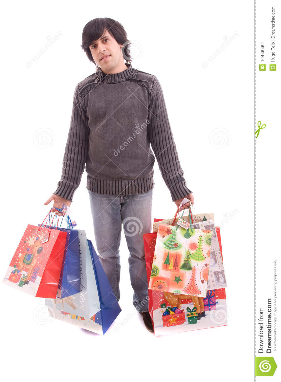 Young Man Full Of Christmas Gifts Stock Photography