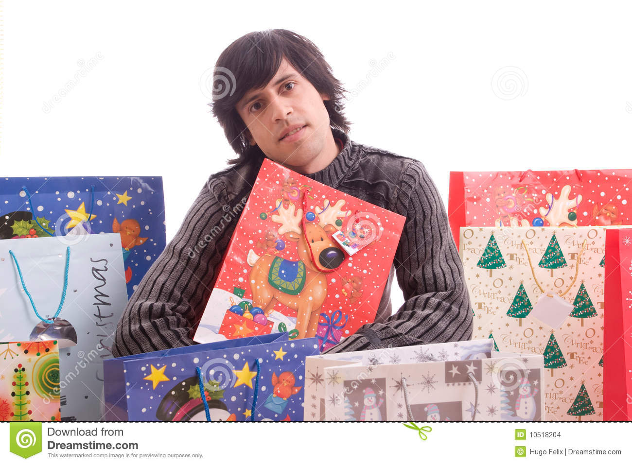 Young Man Full Of Christmas Gifts Stock Images
