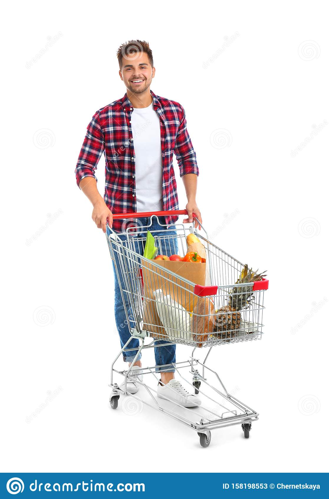Young man with full shopping cart on background