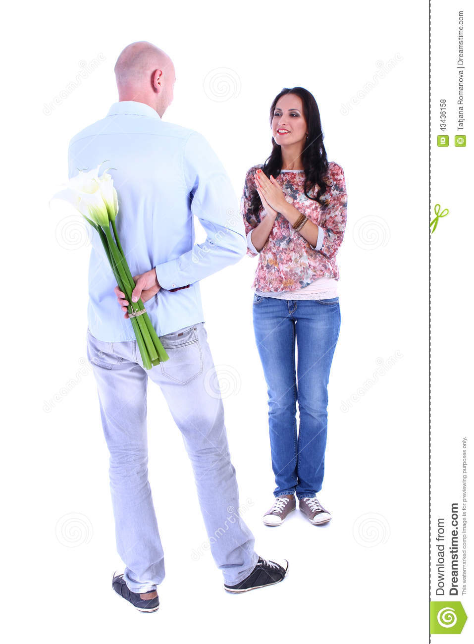 The young man gives his girlfriend bouquet of callas