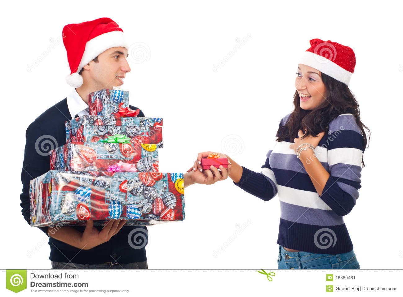 Gifts For Young Men: Woman With Man Holding A Christmas Gift Stock Image
