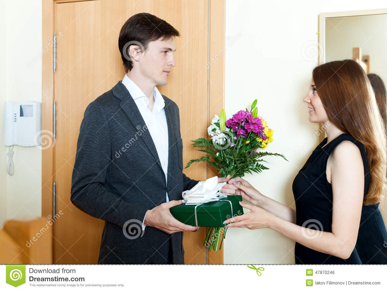 Gifts For Young Men: Young Man Giving Gifts To Girl Stock Photo