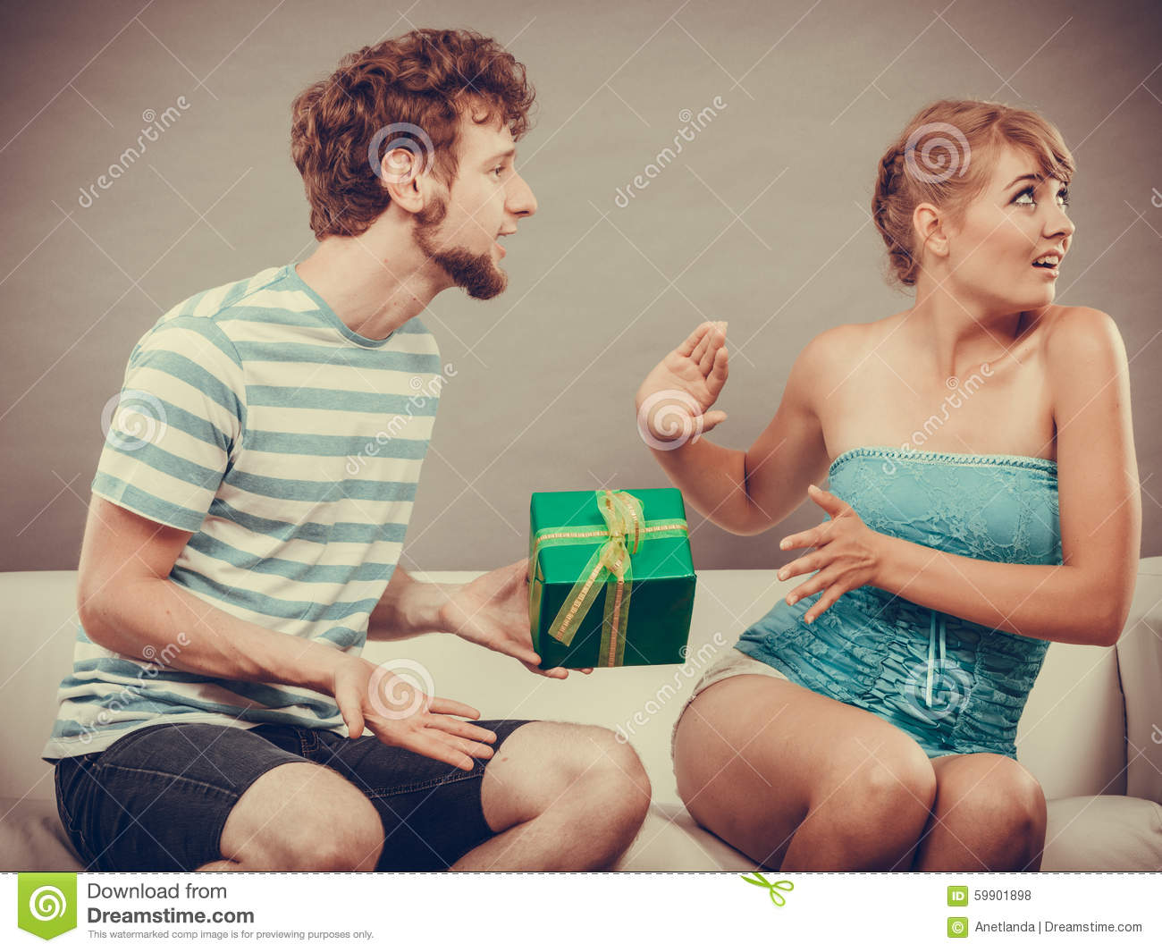 Gifts For Young Men: Young Man Giving Offended Woman Gift Box Stock Photo