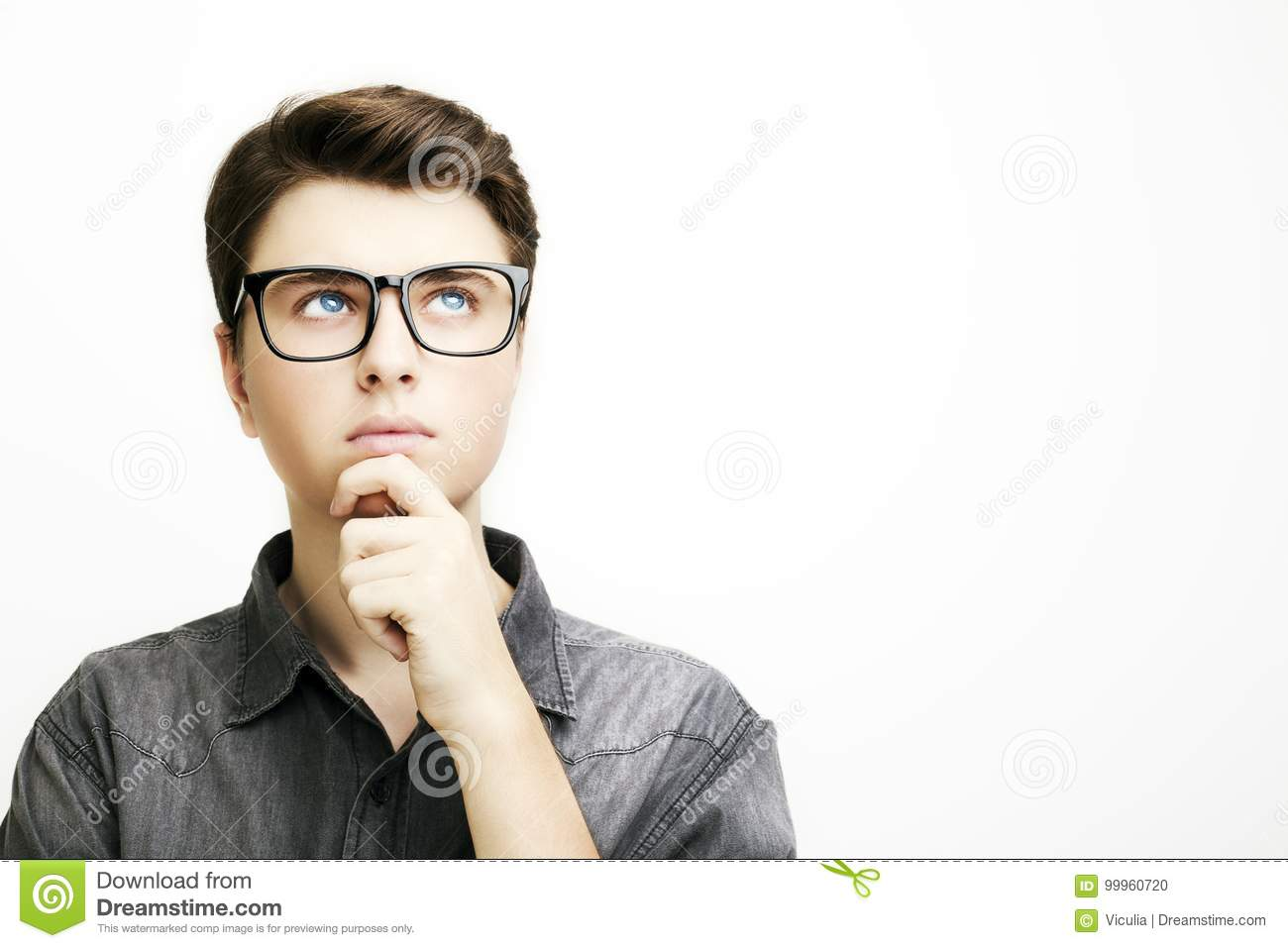 Young man with glasses is thinking on white background.