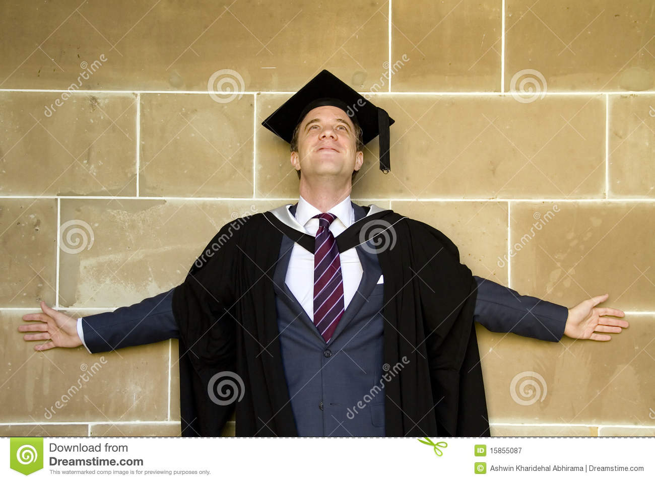 Young European Man In A Graduation Gown. Stock Image - Image of ...