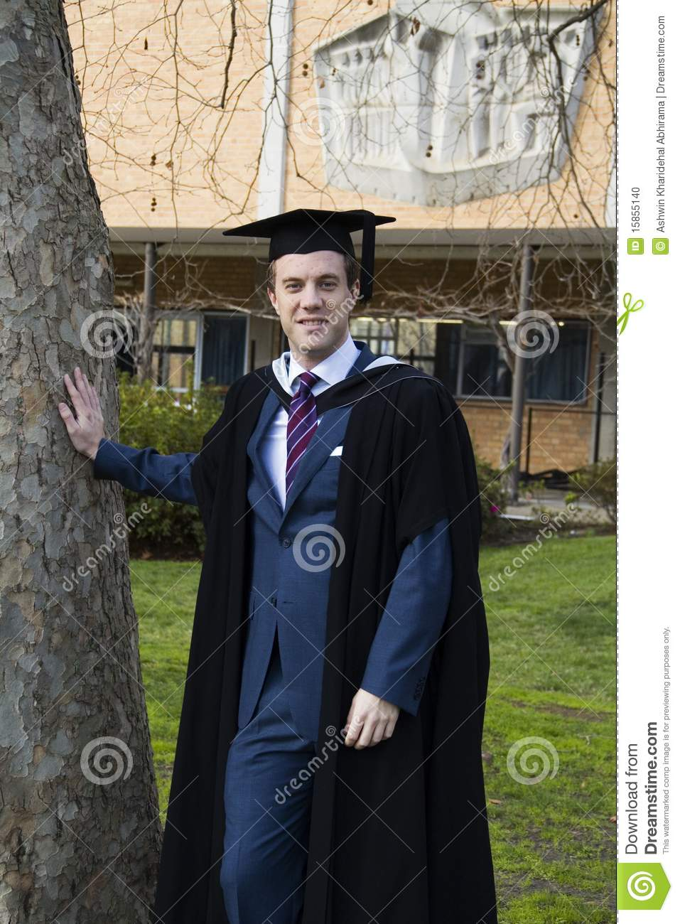 A Young Man In A Graduation Gown Stock Photo Image Of Board
