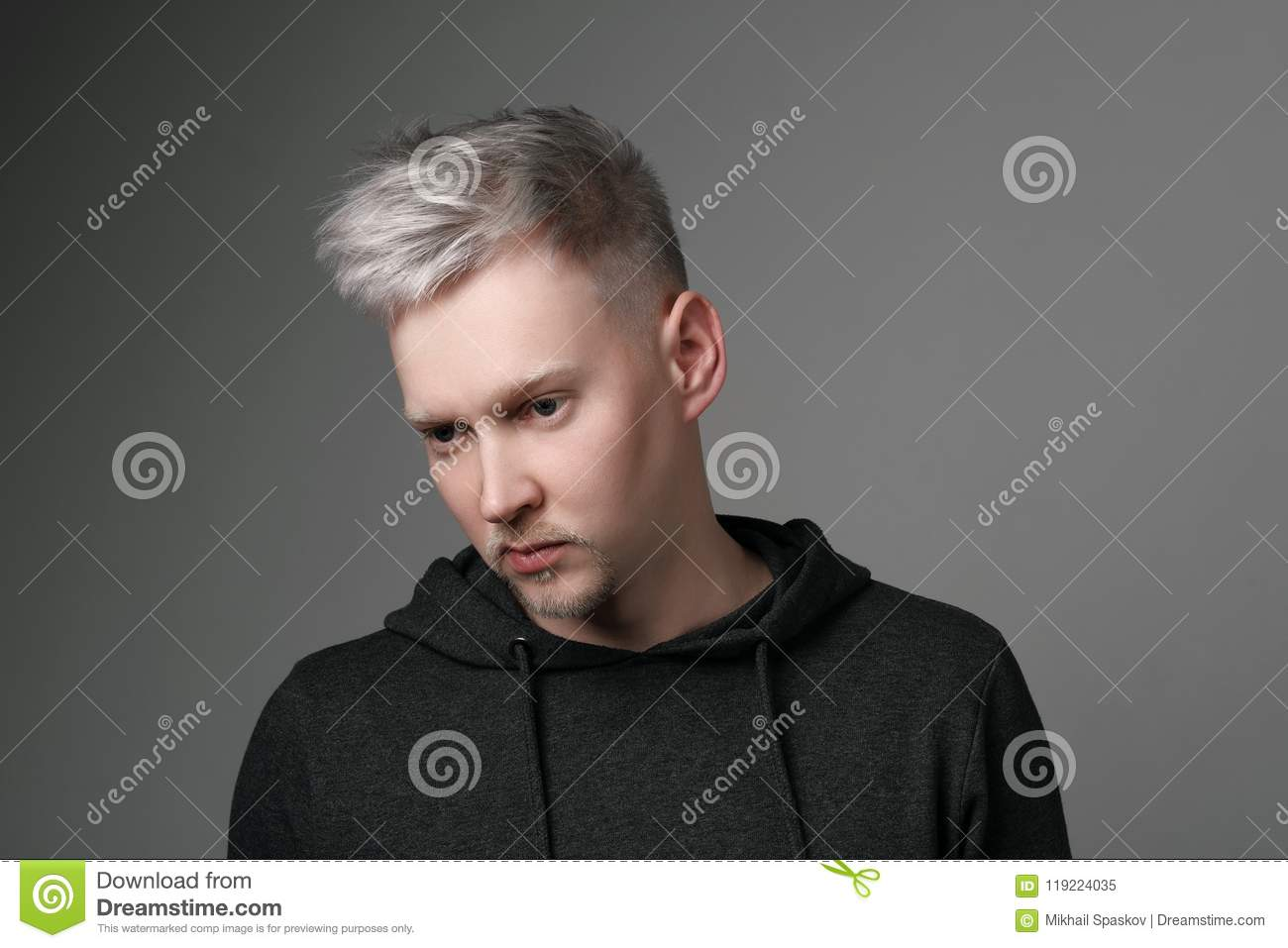 Young Man With Gray Hair In Casual Clothes On White And Gray ...