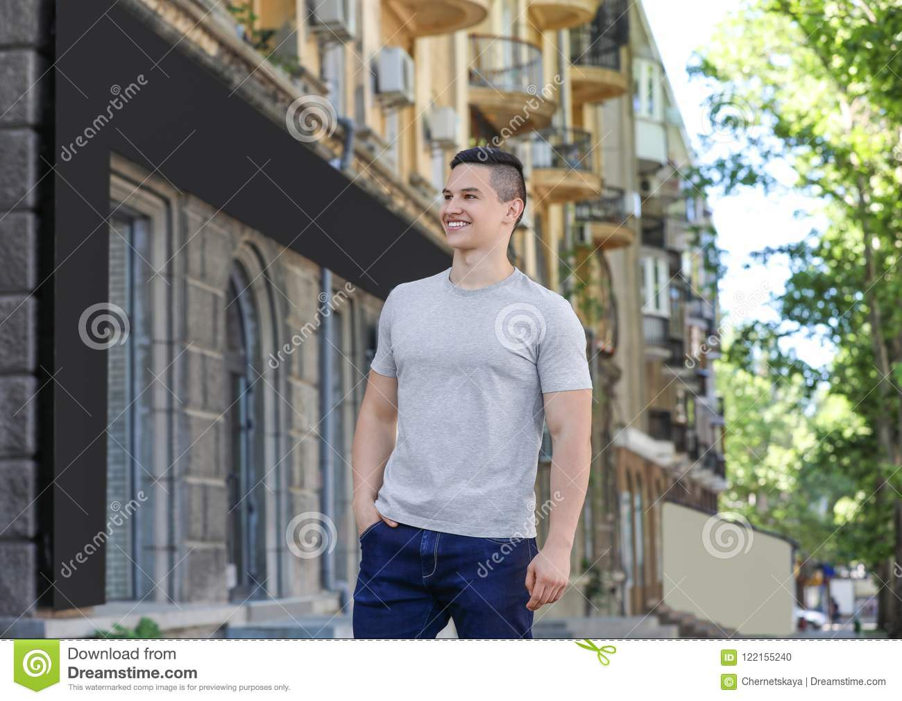 Young man in grey t-shirt outdoors