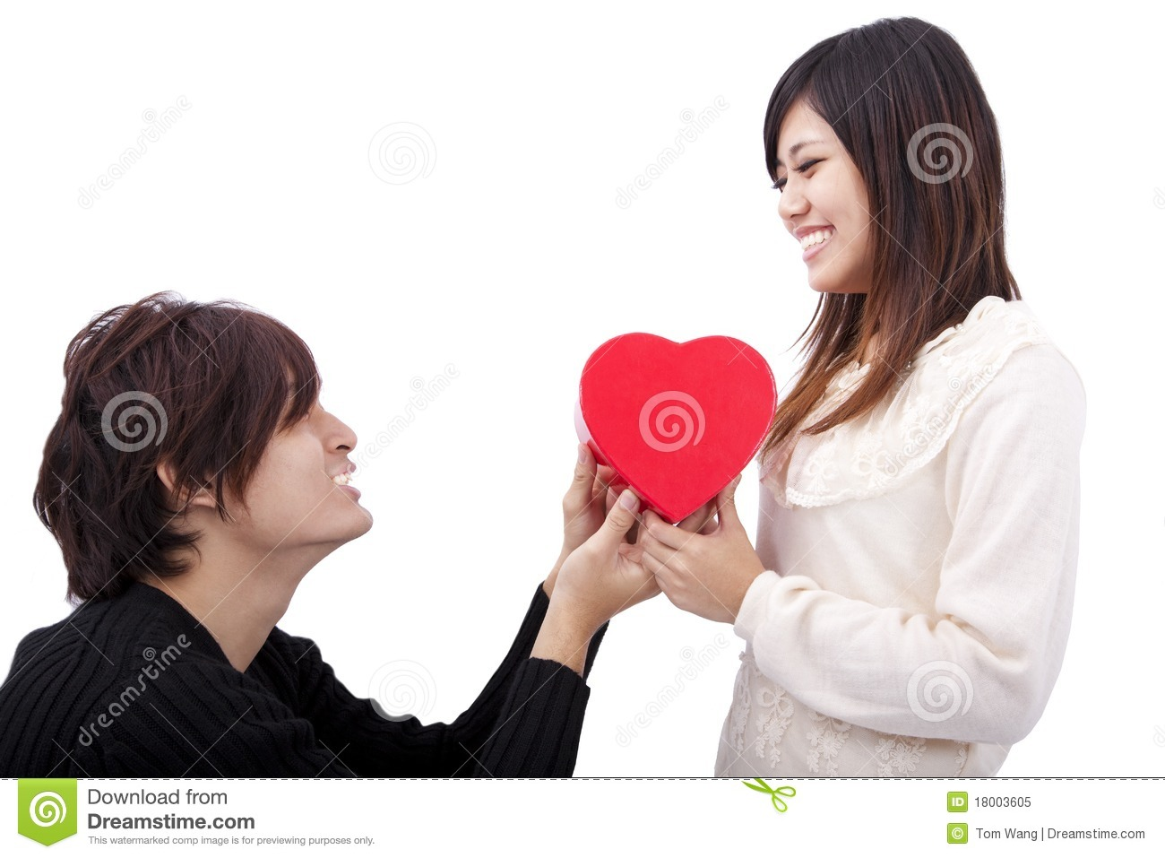 young man handing over love gift to woman stock image