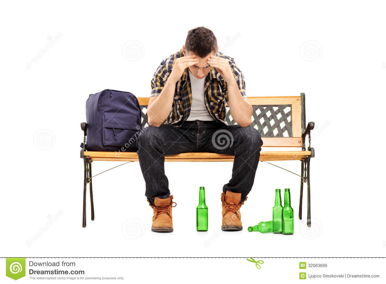 Young Man With Hangover Sitting On A Bench Stock Image Image 32063699