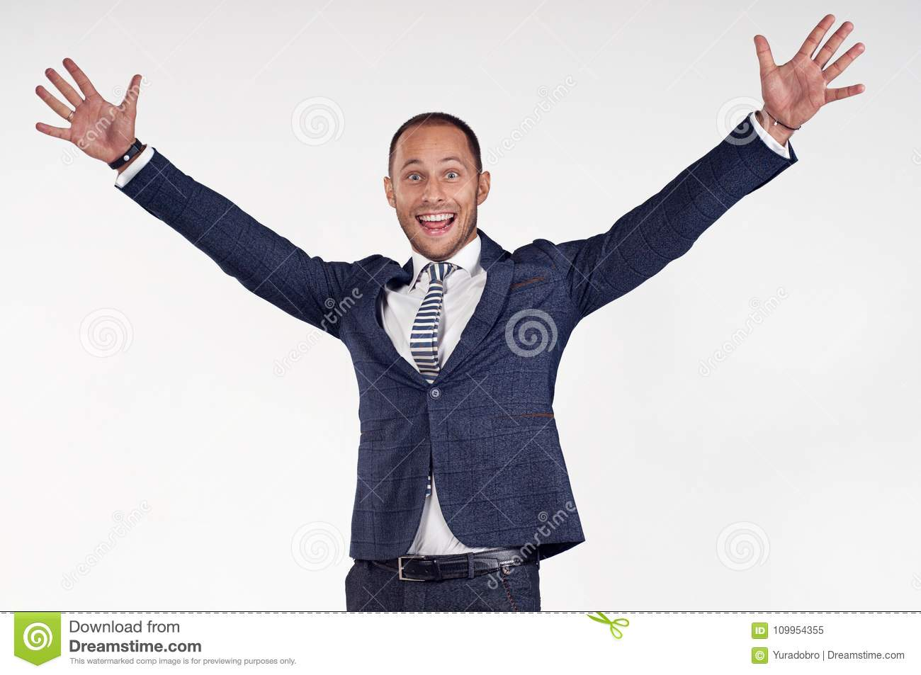 A young man is happy to lift his arms up. The guy is surprised.