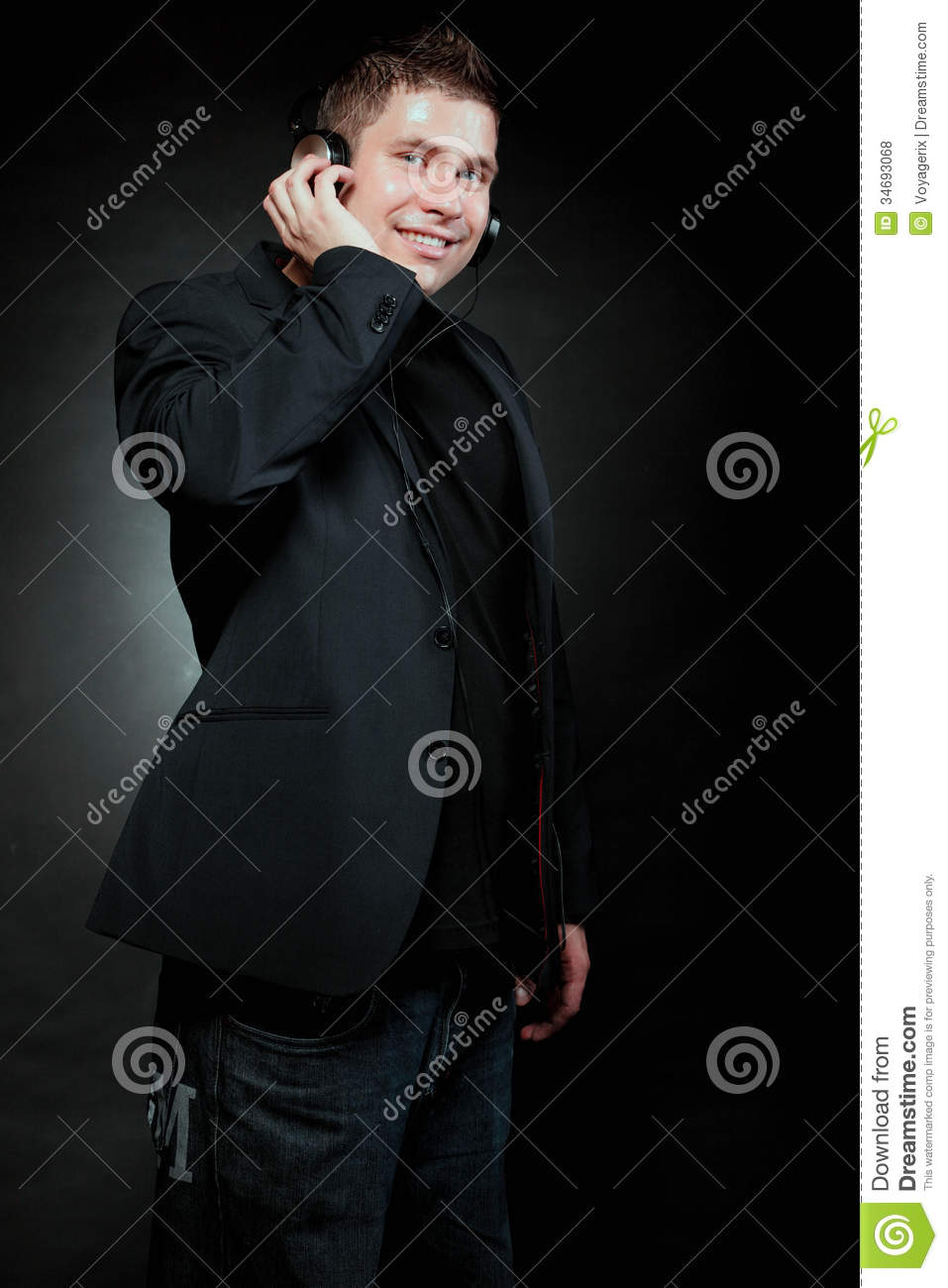 Young Man With Headphones Listening To Music Royalty Free ...
