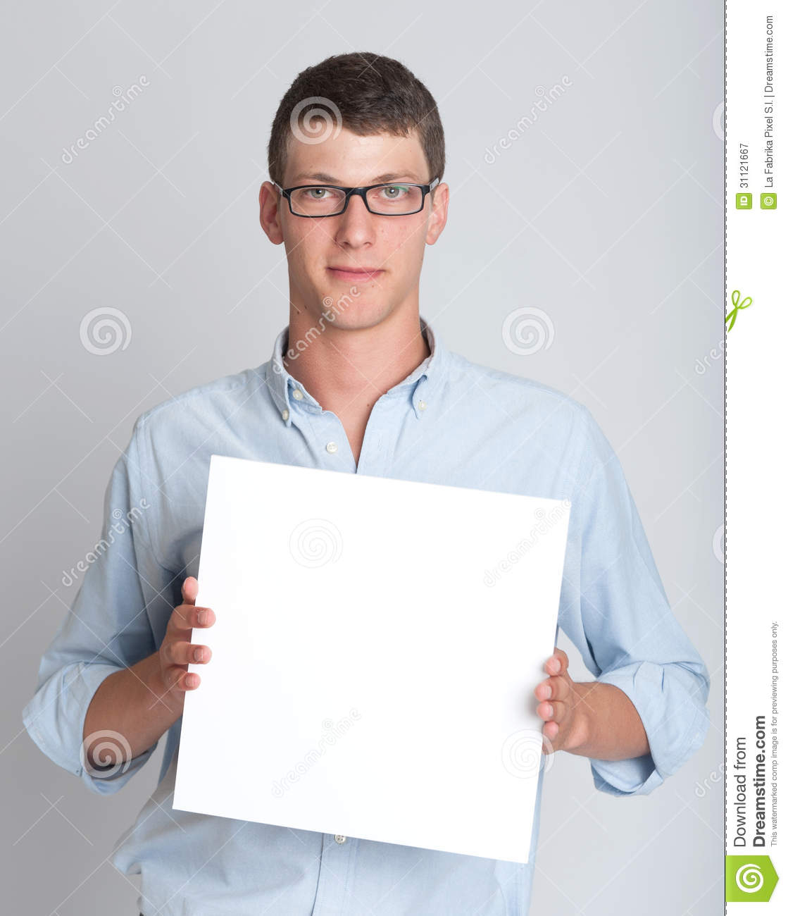 Young Man Holding A Blank Sign Royalty Free Stock