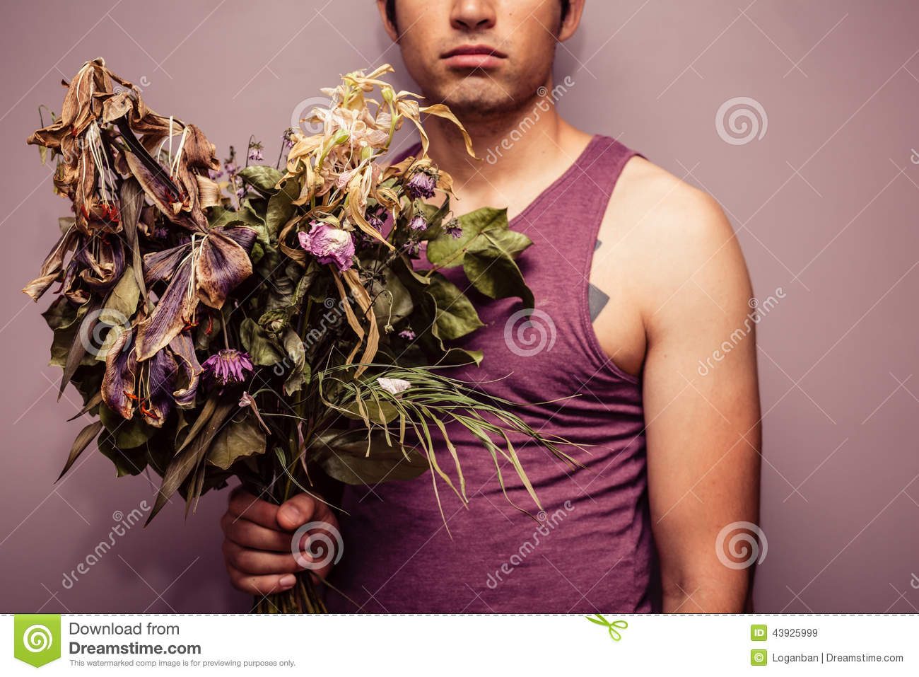 Young man holding bouquet of dead flowers stock image image of young man holding bouquet of dead flowers stock image image of flower male 43925999 izmirmasajfo