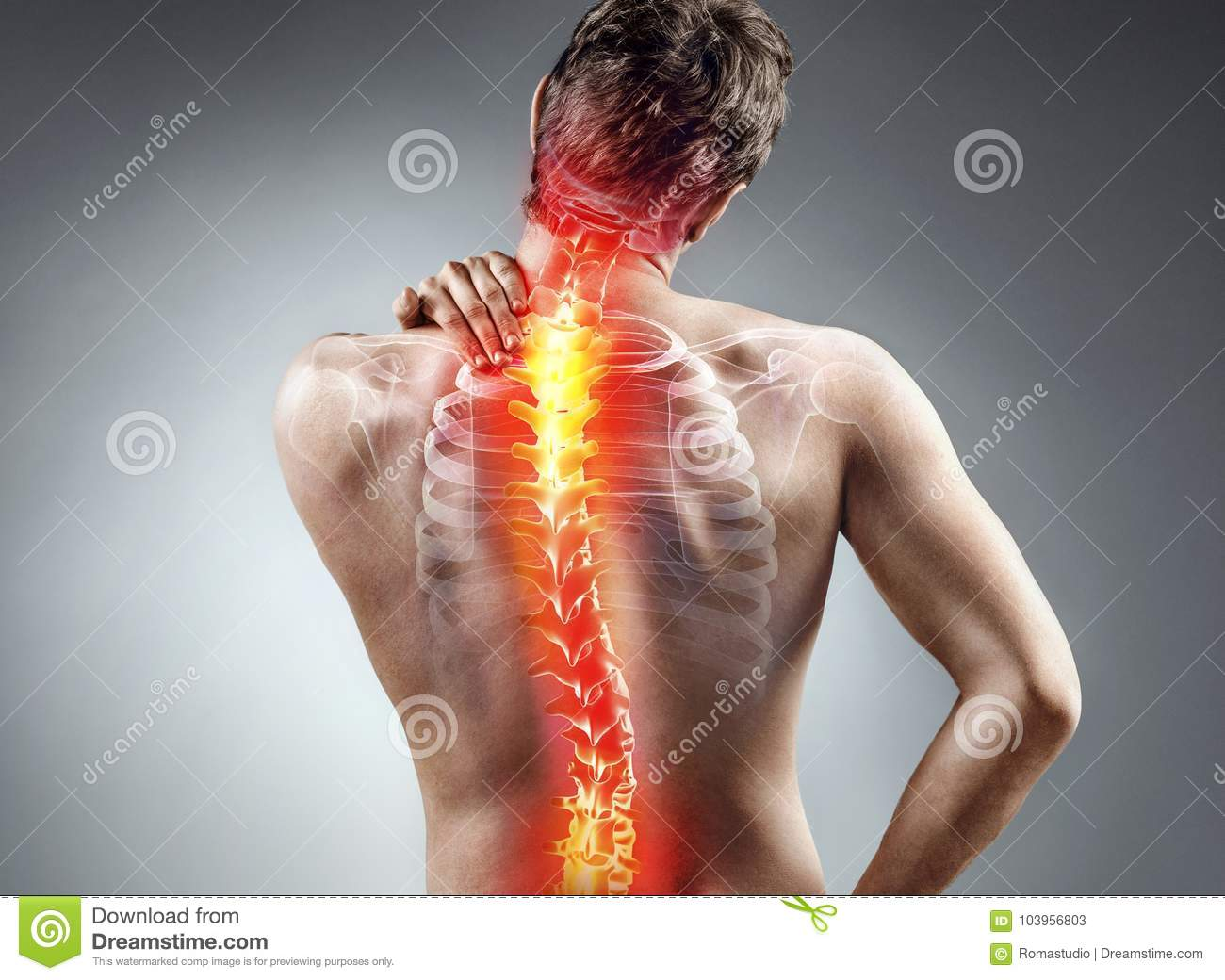 Young man holding his neck in pain.